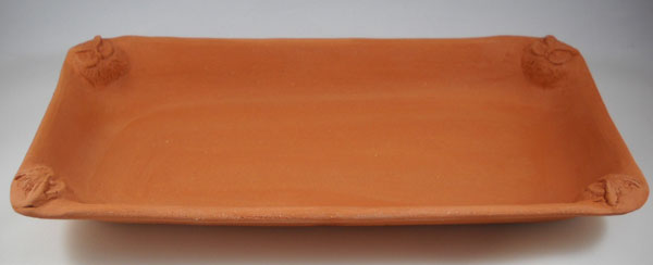Serving/decorative platter made on rectangular hump mold. This bisqued earthenware pottery is not yet glazed.