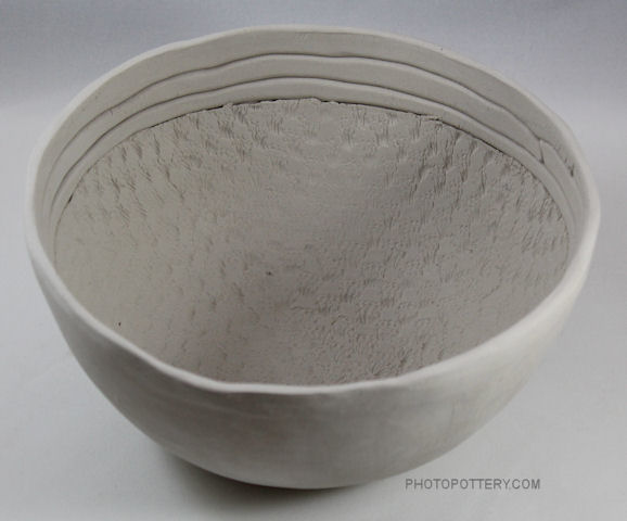 Made on plaster hump bowl mold with clay slab and coils, this pottery bowl is both functional and decorative. Stoneware clay, greenware, not yet bisqued