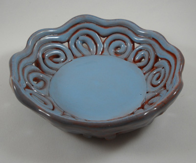 Decorative ceramic bowl made on round plaster drape mold. Sample is in earthenware, slab combined with coils.